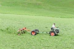 Agricoltore sul suo trattore Immagini Stock Libere da Diritti