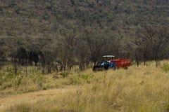 Agricoltore in un trattore Fotografia Stock Libera da Diritti
