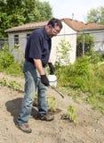 Agricoltore Using uno spruzzo organico Fotografia Stock