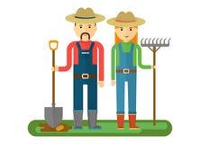 Agricoltori di Local_market con la pala ed il rastrello Fotografia Stock