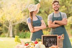 Agricoltori felici che stanno armi attraversate Fotografia Stock Libera da Diritti