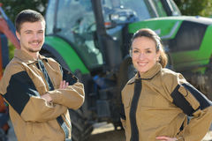 Agricoltori fieri il loro macchinario Fotografia Stock