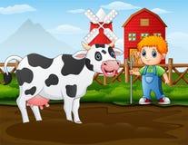 Agriculteur avec une vache devant sa grange illustration de vecteur
