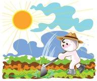 Agriculteurs à l'aide des houes à planter des légumes dans l'après-midi Image libre de droits