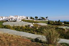 Agricultre by the sea, Maro, Andalusia. View of the village with crops growing under poly-tunnels in the foreground, Maro, Costa del Sol, Malaga Province Stock Images