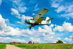 Agricultural aircraft flying low over  field Stock Photos