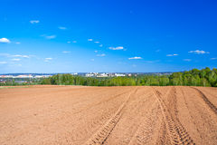 Agricultural arable land field in the spring for crops. The agricultural arable land field in the spring for crops Royalty Free Stock Photography