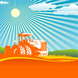 Agricultural background. With a tractor on a wheaten field in  format Royalty Free Stock Photos