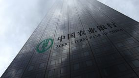 Agricultural Bank of China logo on a skyscraper facade reflecting clouds. Editorial 3D rendering Stock Photography