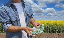 Agricultural concept, farmer, money and field Royalty Free Stock Photo