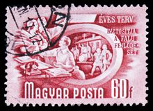 Agricultural cooperation, Five-Year Plan serie, circa 1950. MOSCOW, RUSSIA - FEBRUARY 10, 2019: A stamp printed in Hungary shows Agricultural cooperation, Five royalty free stock photo
