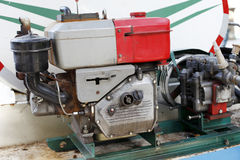 Agricultural diesel engine. Small agricultural Diesel Engine,It is used for spraying pesticides in fruit trees to prevent pests and diseases Stock Image