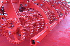 Red giant farming plough Stock Photography