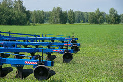 Agricultural equipment ready for ploughing the fields Stock Photography