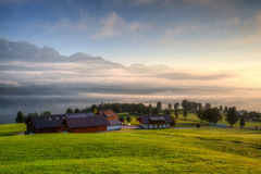 Agricultural farm on the hills in the Planai at sunrise Royalty Free Stock Photo