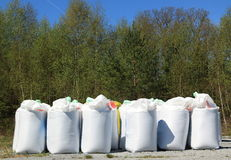 Agricultural Fertilizer. 600kg packs of agricultural fertiliser stand ready for dispersal on the fields to provide nutrients for the new crops Stock Image