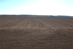 Agricultural field freshly harrowed. An agricultural open field that has been freshly harrowed and ready for winter planting to take place. The freshly harrowed royalty free stock photo