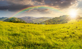 Agricultural field in mountains at sunset Stock Image