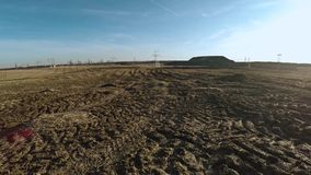 Agricultural field and power lines 26. Agricultural field and power lines. 26 stock video footage