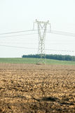 Agricultural field , with pylons Stock Images