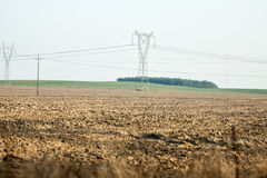 Agricultural field , with pylons Stock Photos