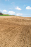 Agricultural field with soil and blue sky. With copy space Stock Image