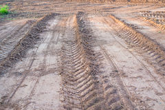 Agricultural field on which drove heavy vehicles. Ruts from the wheels in the mud, formed after the rain stock images