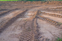 Agricultural field on which drove heavy vehicles. Ruts from the wheels in the mud, formed after the rain royalty free stock image