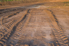 Agricultural field on which drove heavy vehicles. Ruts from the wheels in the mud, formed after the rain royalty free stock photo