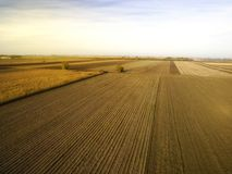 Agricultural fields in Autumn. Autumn morning above agricultural fields after harvest season Stock Images