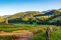 Agricultural fields on hills sunrise. Agricultural fields on hills in mountainous rural area at sunrise Stock Photo