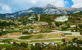 Agricultural fields in the Italian Alps. Agricultural fields and small houses in the Italian Alps, Italy Royalty Free Stock Photography