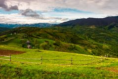 Agricultural fields in mountains. Beautiful Carpathian landscape with mountain ridge in the distance. cloudy springtime day stock photo
