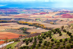 Agricultural fields under cloudy sky. View down the hill at agricultural fields under cloudy sky Royalty Free Stock Photo