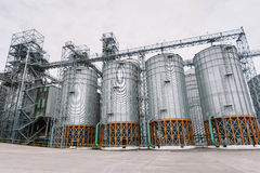 Agricultural grain elevator building for corn storage and railroad. Royalty Free Stock Image