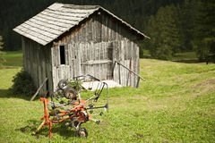 Agricultural implement and hut Royalty Free Stock Images