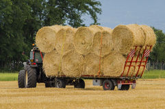 Agricultural labor. Transport bales of hay Royalty Free Stock Photo