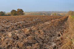 Agricultural land. Field of freshly turned topsoil forming large clods of earth Stock Image