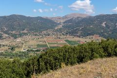 Agricultural land and the city of Kalavryta from a height Achaea, Greece, Peloponnese. Agriculture. Agricultural land and the city of Kalavryta from a height in stock image