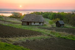 Agricultural land near old wooden house. Rural landscape with ri Royalty Free Stock Images