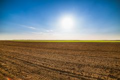 Agricultural landscape, arable crop field. Arable land is the land under temporary agricultural crops capable of being ploughed and used to grow crops Stock Photos