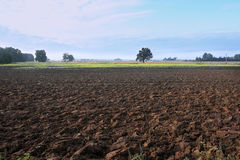 Agricultural landscape, arable crop field. Countryside landscape arable. Plowed soil in  farmland Stock Photography
