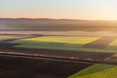 Agricultural landscape, arable crop fields. Agricultural landscape, arable crop field Royalty Free Stock Images
