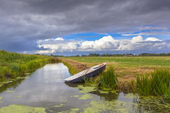 Agricultural Landscape with Boat and Canal In Friesland, Netherl Stock Photos