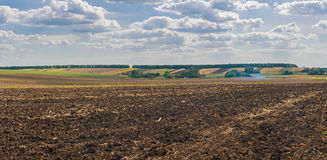 Agricultural landscape at fall season Stock Photos