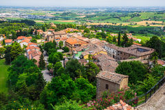 Agricultural landscape with old village in toscana Royalty Free Stock Photo