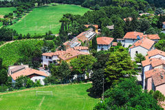 Agricultural landscape with old village in toscana Royalty Free Stock Images