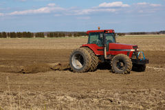 Agricultural landscape. tractor plowing the fields Royalty Free Stock Photography