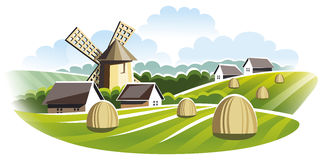 Agricultural landscape. Windmill in field. Royalty Free Stock Photo