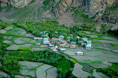 Agricultural lanscape in Northern India. With small village and terraced fields Stock Photos